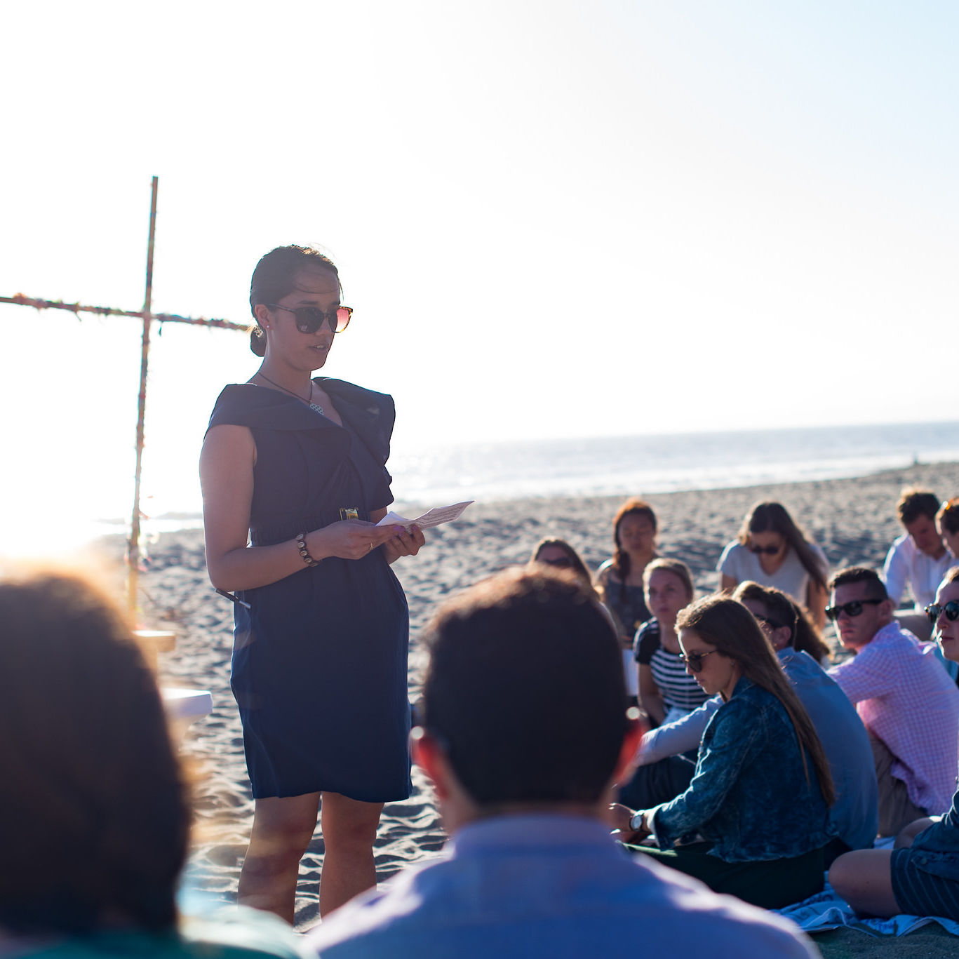 Lilly Roggerkamp (JVC Staff) reading during Orientation mass taking place at Camp St. Francis in California in 2016.