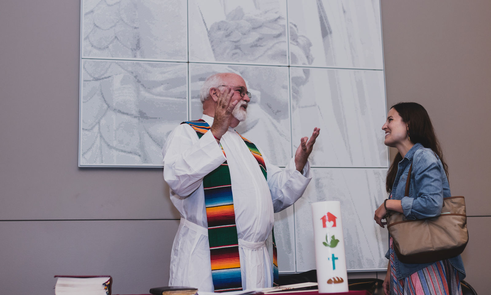 Fr. Greg Boyle talks with a Jesuit Volunteer before 2018 Orientation commissioning mass.