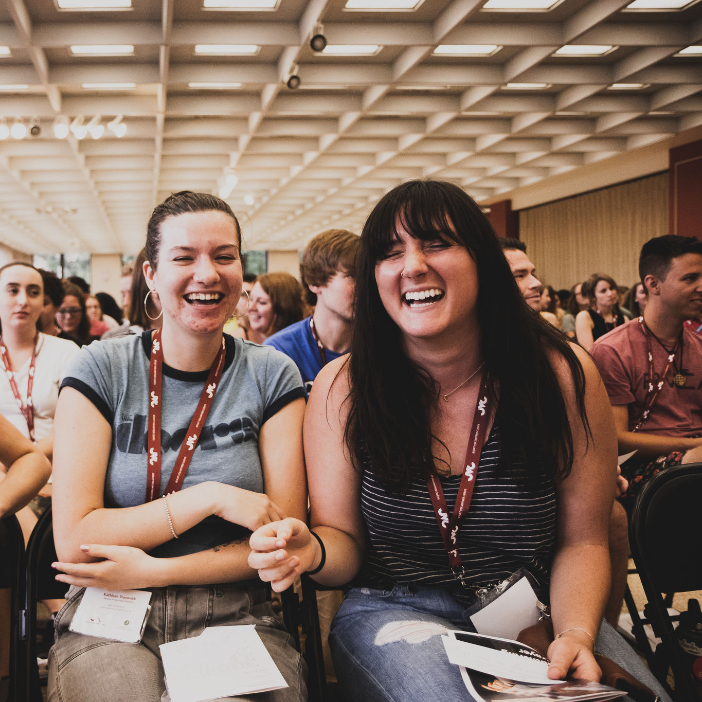 Jesuit Volunteers laugh while seated at Orientation 2018 in Chicago.