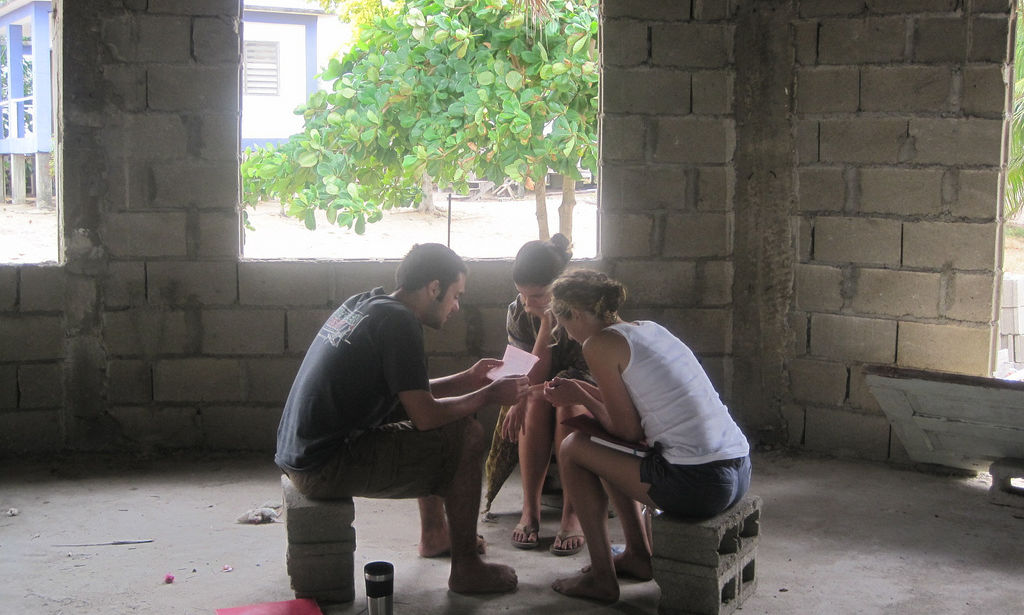 Jesuit Volunteers serving internationally with JVC in Punta Gorda, Belize in a new building structure. (2011)