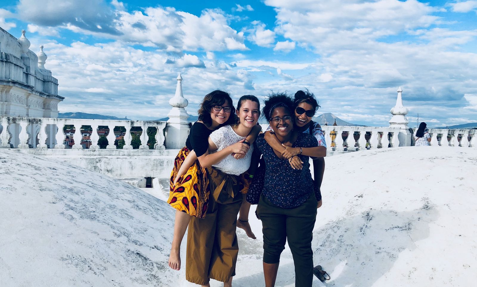 Managua, Nicaragua Jesuit Volunteers prior to JV community house closure in 2017 due to civil unrest in the country. JVC Nicaragua exploring the roof of Basilica de la Asunción in Leon. Pictured left to right is Glendys Orellana (2016-18), Rachel Schwarz (2017-19), Paola Joaquin Rosso (2017-19), and Luvy Martinez, a friend and coworker. Photograph taken by a passerby.