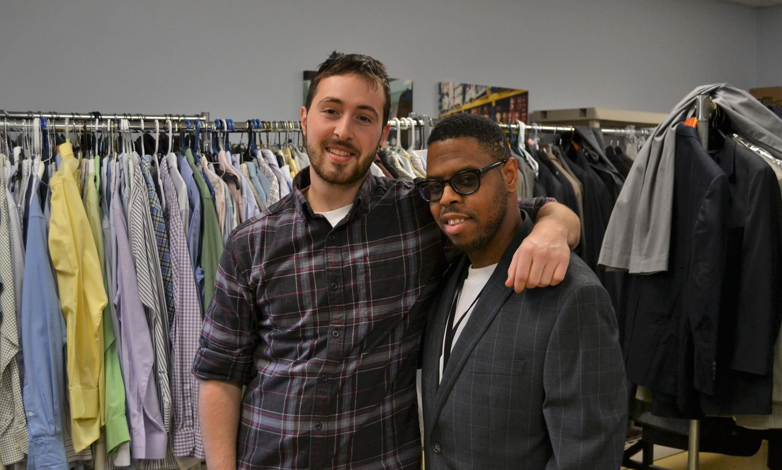 Former Jesuit Volunteer Gabe McCarthy (2017-18) helps Erik Cheeks find a suit for an upcoming job interview.