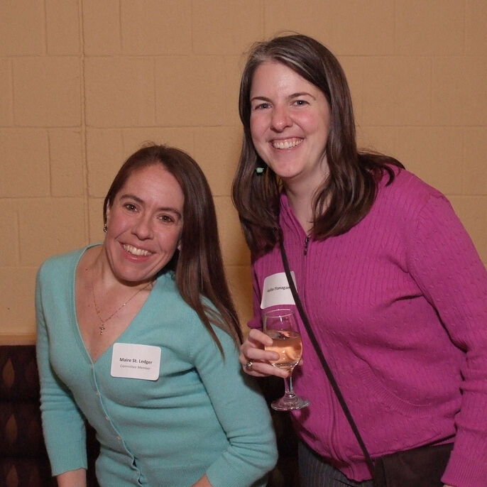 Marie St. Ledger and a JVC community member at a dinner event. (2010)
