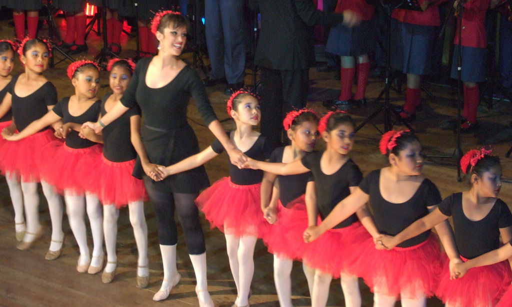 Chelsea Mulvey and her ballet students from Colegio Miguel Pro performed with the school's orchestra to celebrate the 50th anniversary of the Jesuits' arrival in Tacna.  (2009)