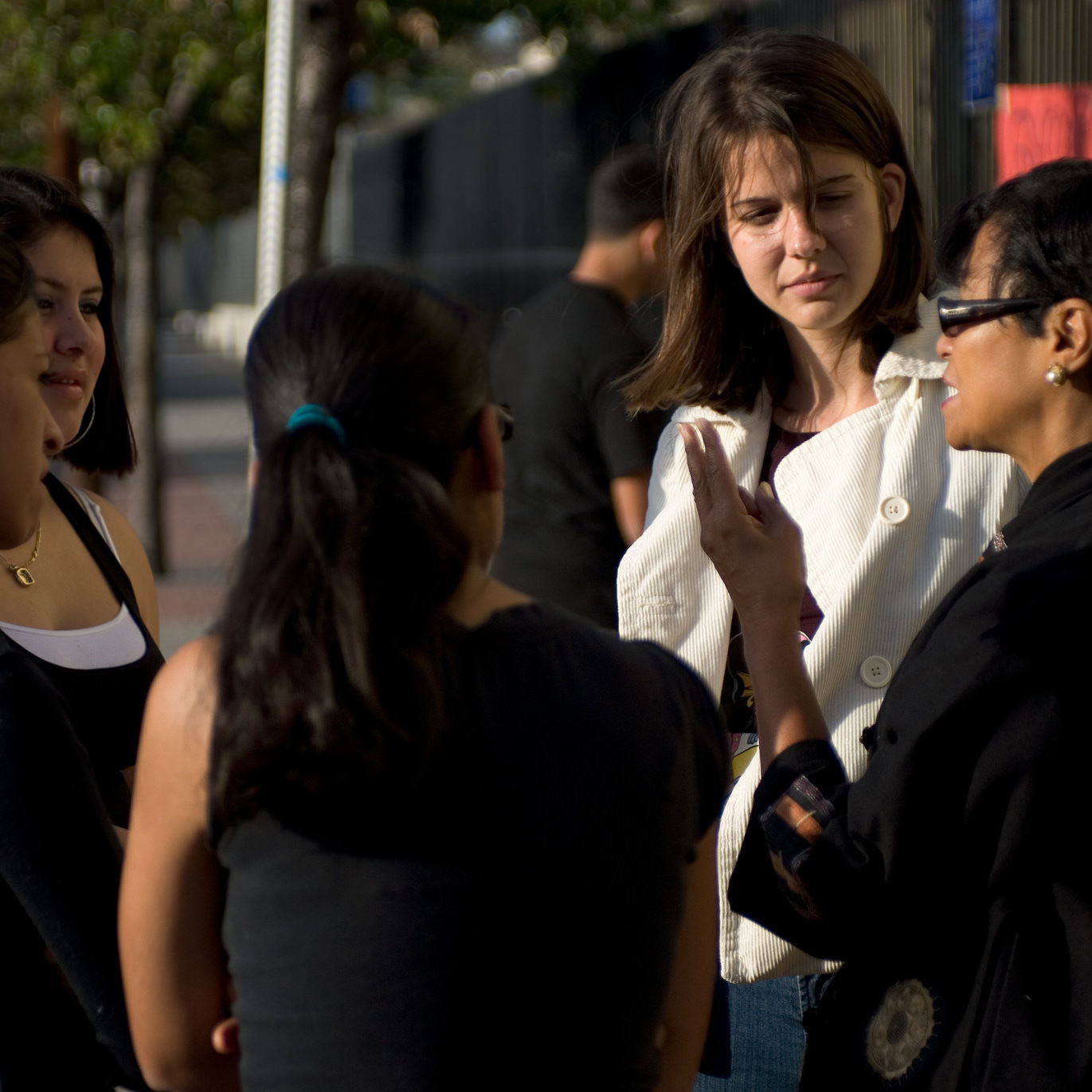 Jesuit Volunteer engaging in a conversation on social justice issues in the local community. (2010)