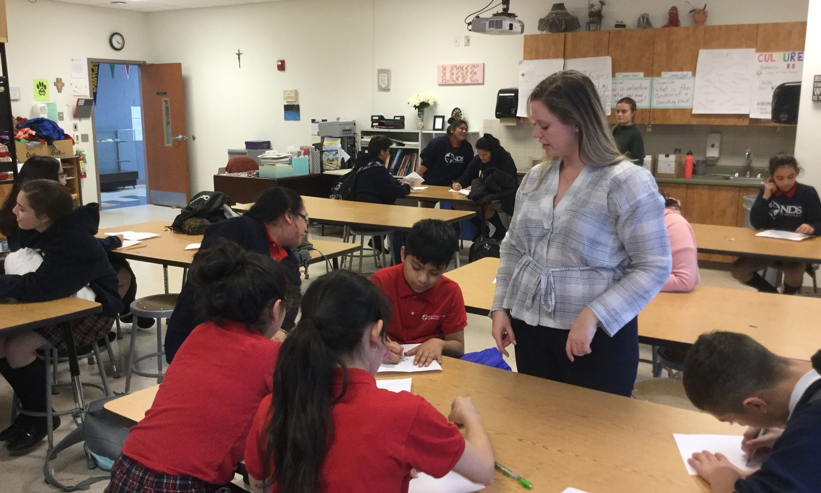 Jesuit Volunteer at Notre Dame School of Milwaukee, Marie McDonald-Hulen assists with the after school program. (2018)